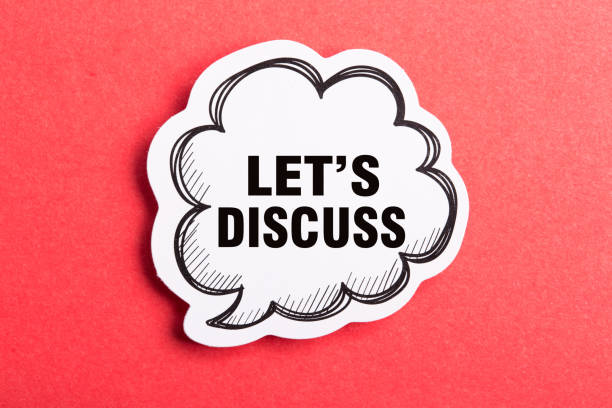 Let Us Discuss Speech Bubble Isolated On Red Background stock photo
