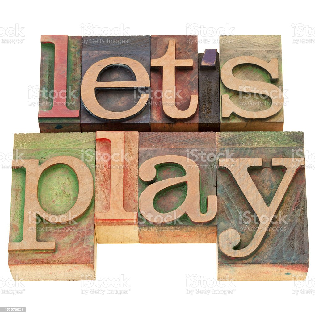 let us play -  letterpress text royalty-free stock photo