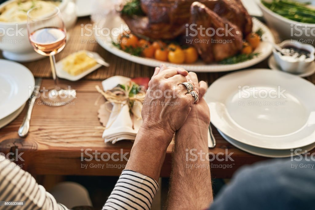 Let's all join hands and say thanks stock photo
