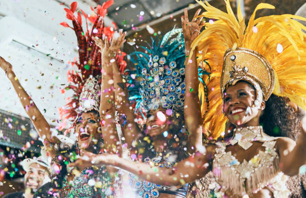 Let's dance all our troubles away Cropped shot of beautiful samba dancers performing in a carnival with their band costume stock pictures, royalty-free photos & images