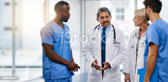 istock Let's discuss tasks for today's shift 869288072
