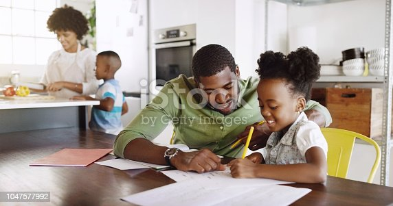 Cropped shot of a young handsome father helping his daughter with her schoolwork at home