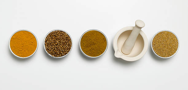 lets get cracking mortar and pestle with herbs in individual bowls garam masala stock pictures, royalty-free photos & images