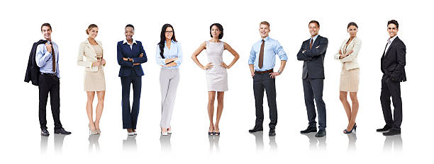 Let's get down to business Studio shot of a row of businesspeople in various poses akimbo stock pictures, royalty-free photos & images