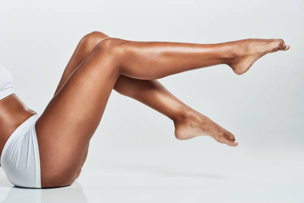 Let's get leggy Cropped shot of a young woman's legs against a grey background leg stock pictures, royalty-free photos & images