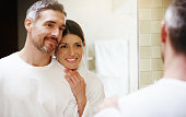 Shot of a mature couple taking getting ready in the bathroom at home