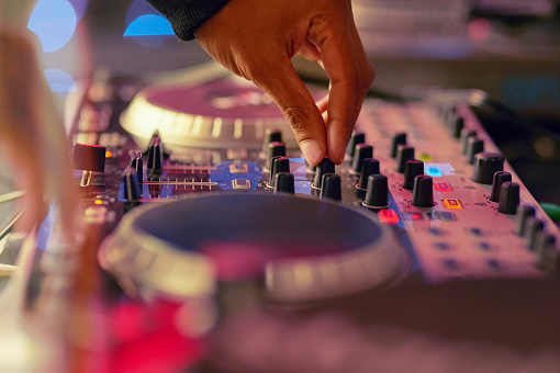 Closeup shot of a DJ  mixing music on a turntable