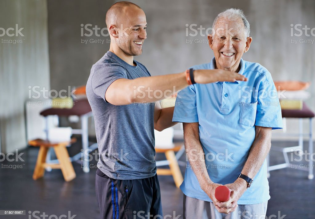 Let's get those weights up to here stock photo