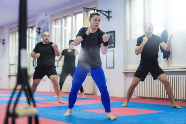 Let's go fight A group is doing self - defence exercises self defense stock pictures, royalty-free photos & images