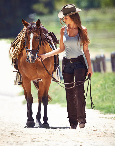 Let's go girl... A gorgeous cowgirl leading her horse along a country lanehttp://195.154.178.81/DATA/i_collage/pi/shoots/783278.jpg alongside stock pictures, royalty-free photos & images