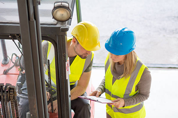 Let`s go through the list again Coworkers in warehouse checking order reflective clothing stock pictures, royalty-free photos & images