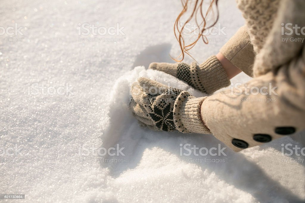 Let's make a snowball! stock photo