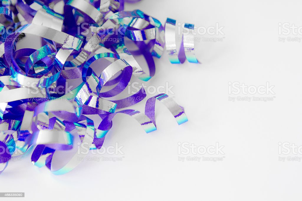 Let's Party! Purple, blue and silver streamers stock photo