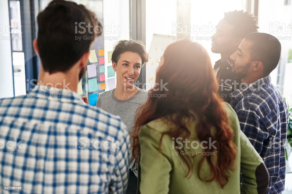 Let's put our heads together and solve this project stock photo