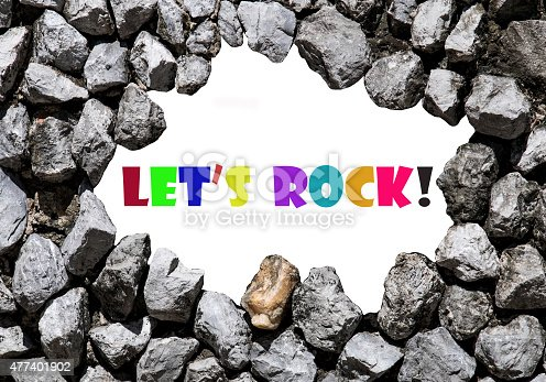 istock Let's rock wrote on the stone wall 477401902