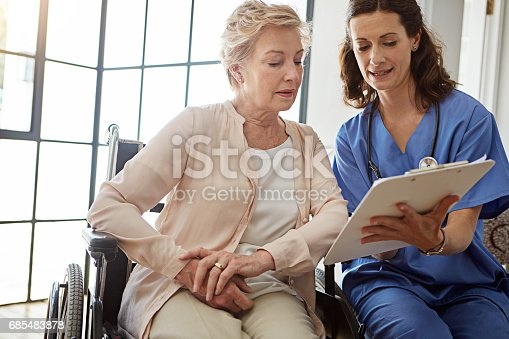 Cropped shot of a female nurse talking to a senior patient in the retirement home