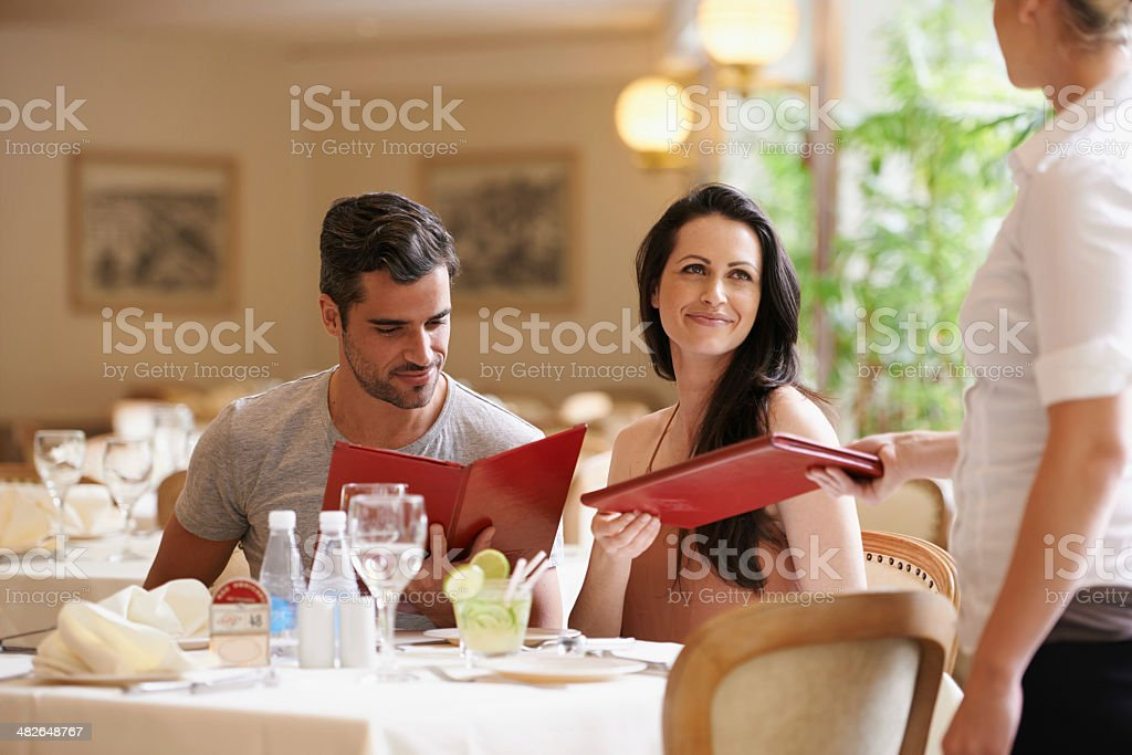 Let's see what they have on the menu... stock photo