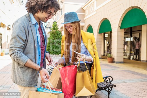 young couple in shopping