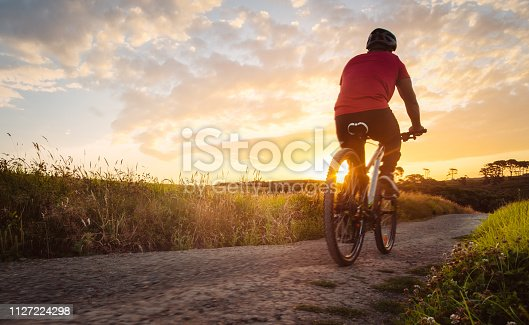 Bike riding outdoor during sunset in Long Bay, Auckland, New Zealand.