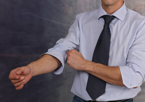 Let's start working. Businessman Rolling Up Sleeves stock photo