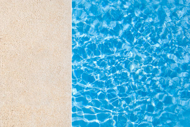 Let's swim Edge of e swimming pool.Related images; poolside stock pictures, royalty-free photos & images