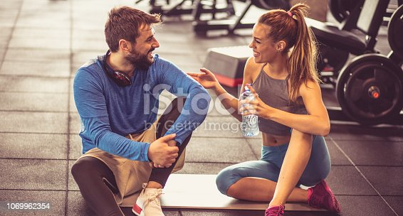 Let's take a bit of a breather. Personal trainer and sportswoman having conversation after exercise.