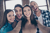 istock Let's take a picture! One two three smile! Close up portrait of carefree cheerful restless joyful funny people taking a picture on modern smartphone 960176988