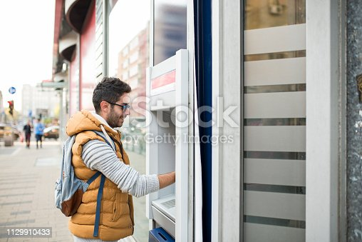 945598452 istock photo Lets take some cash 1129910433