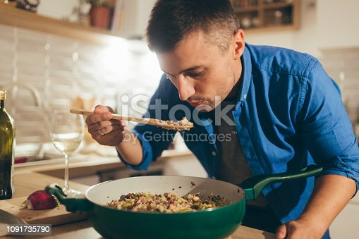 Young man is tasting risotto