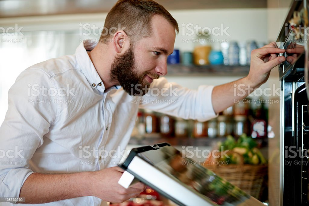 Let's turn the grill on for a few minutes stock photo