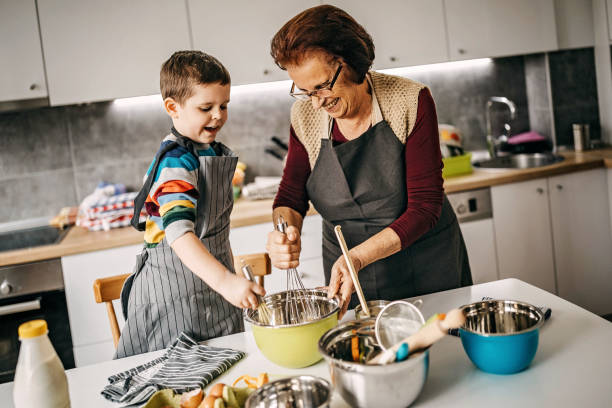 Let's your granny show you how to make a cake stock photo