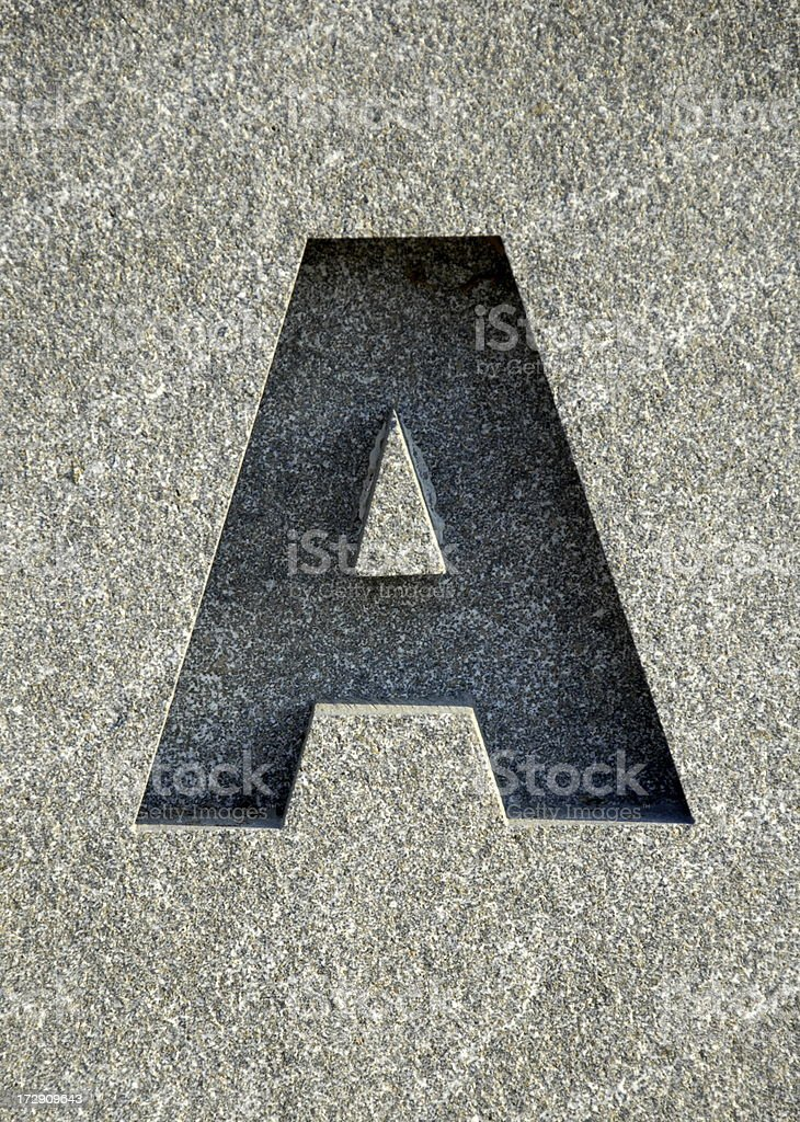 Letter A carved into stone stock photo