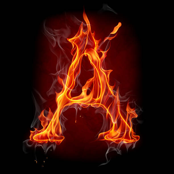 Letter A catching fire in the dark stock photo