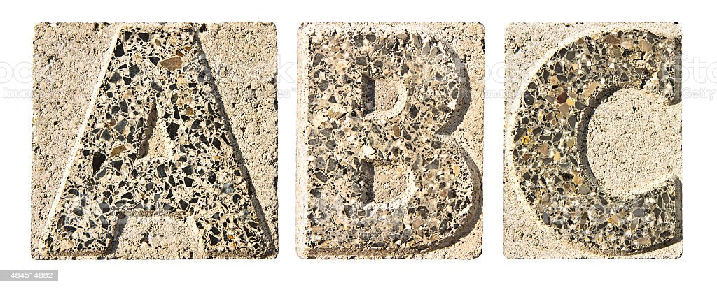 Letter A-B-C carved in a concrete block stock photo
