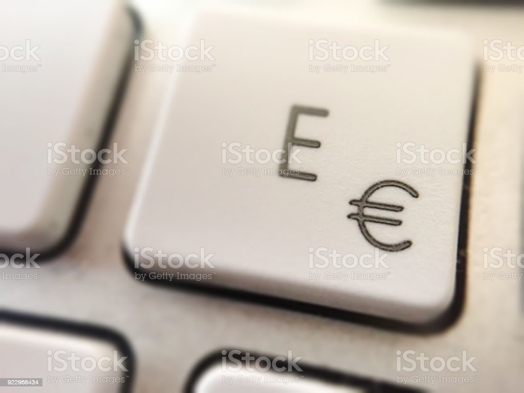E Letter And Euro Coin Symbol On A Pc Keyboard Button Stock Photo