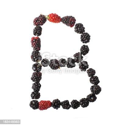 683035640 istock photo Letter B made up of blackberries 183448563