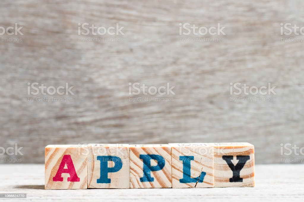 Letter block in word apply on wood background stock photo