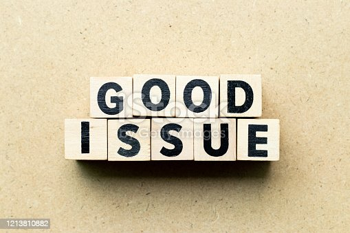 istock Letter block in word good issue on wood background 1213810882
