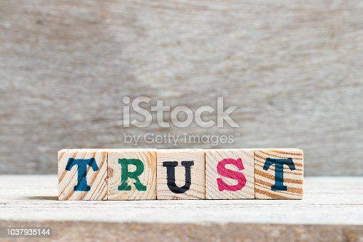939533958 istock photo Letter block in word trust on wood background 1037935144