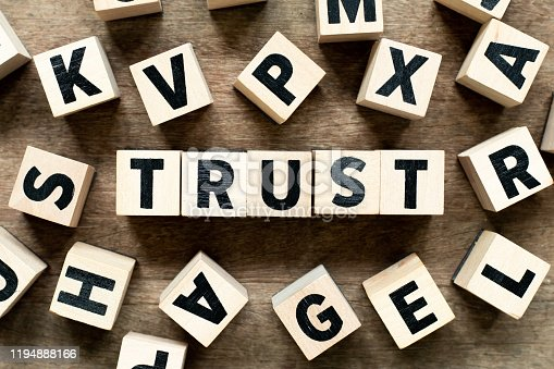 939533958 istock photo Letter block with word trust on wood background with another alphabet as frame 1194888166