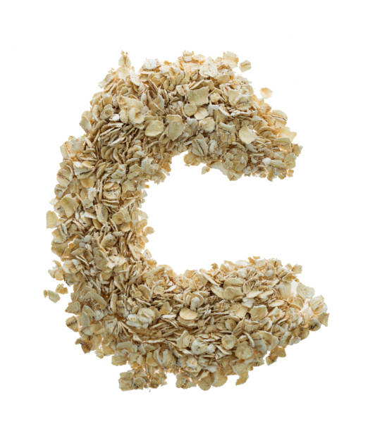Letter C made with oat flakes stock photo