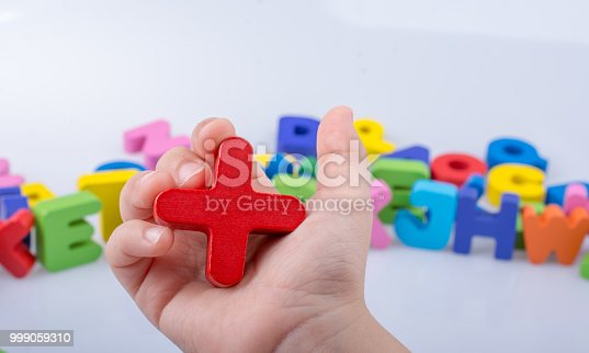 istock Letter cube of plus sign made of wood 999059310