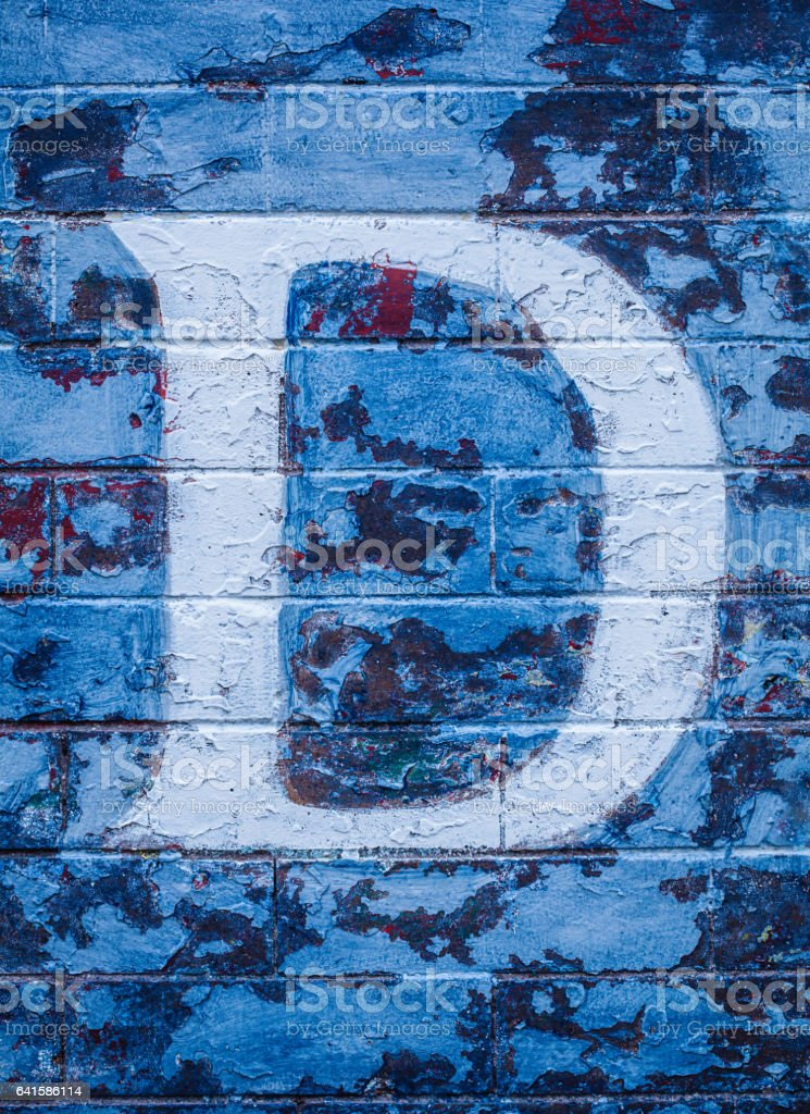 Letter D on a wall stock photo
