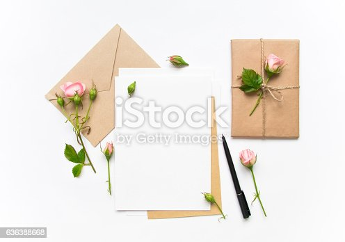 istock Letter, envelope and gift with roses. Holiday concept, top view 636388668