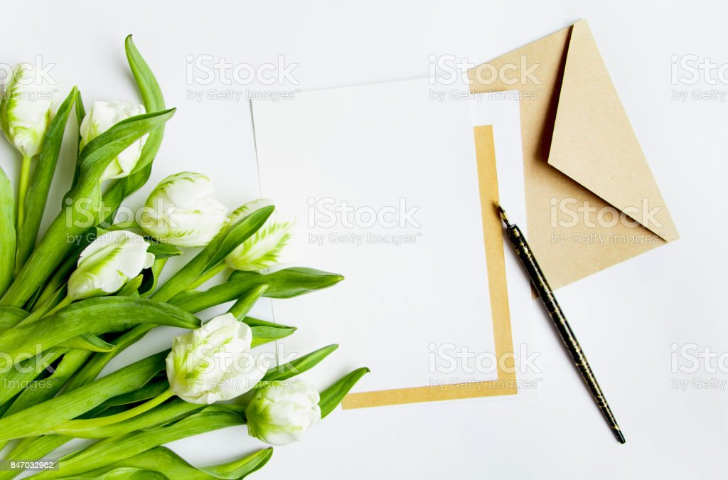 Letter envelope and tulips on white background invitation card or letter envelope and tulips on white background invitation card or love letter stopboris Images