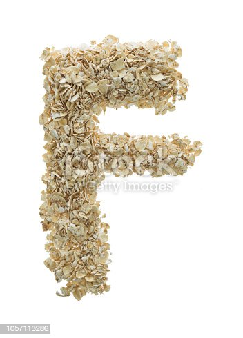 Letter F made with oat flakes.