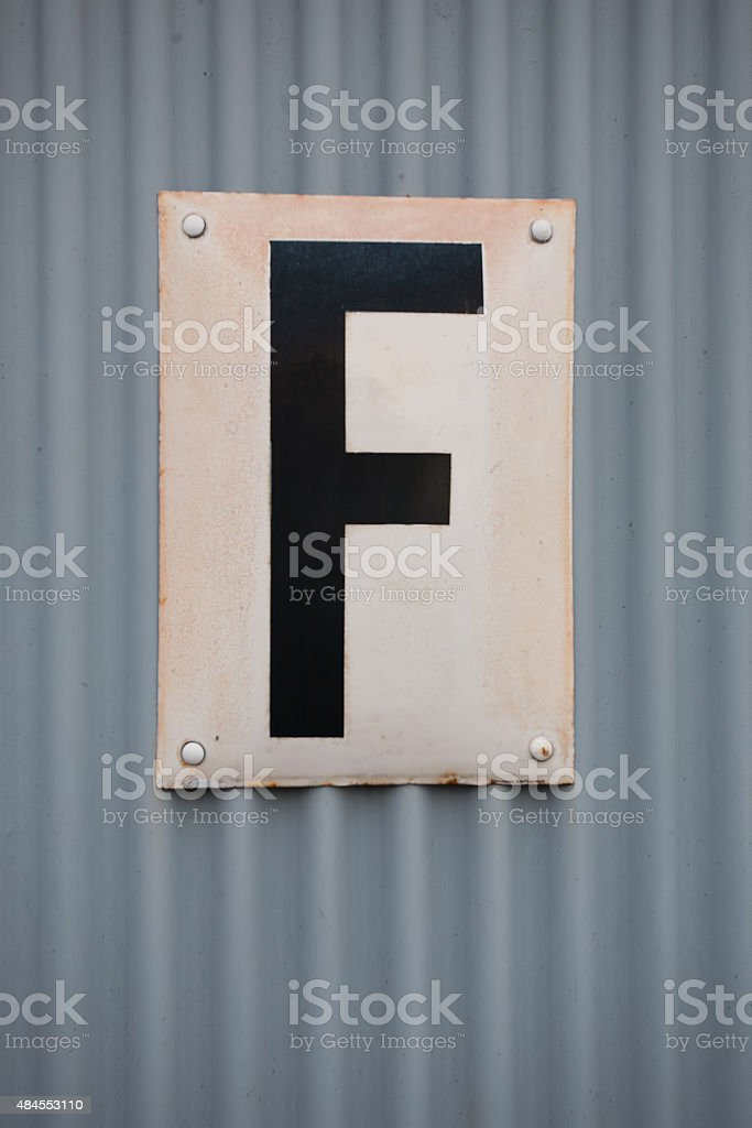 Letter F on corrugated sheet iron stock photo