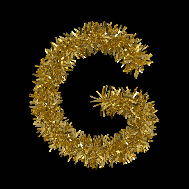 Letter G made from Gold Christmas Tinsel Isolated on Black stock photo