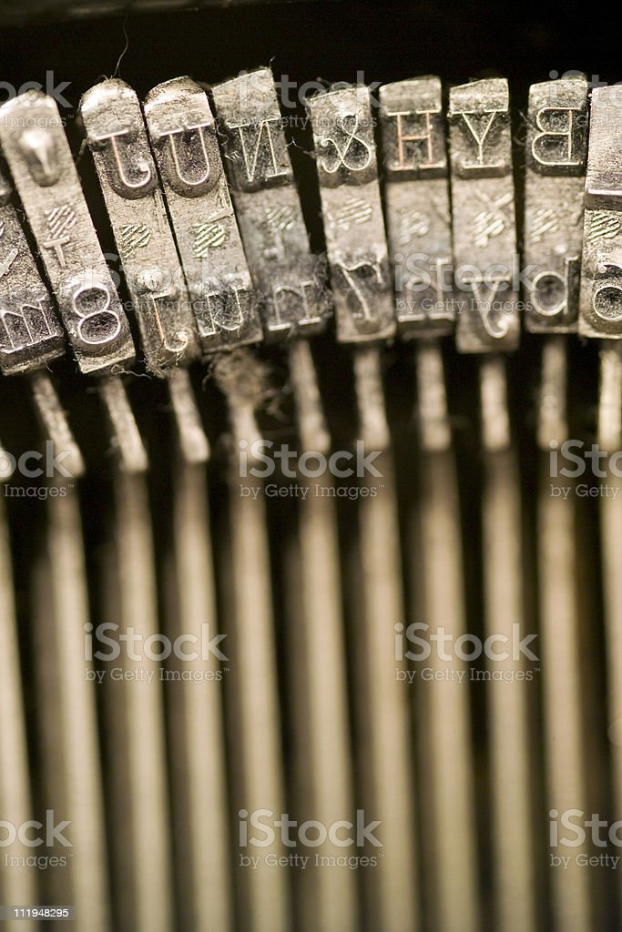 Letter hammers on a old typewriter narrow dof royalty-free stock photo