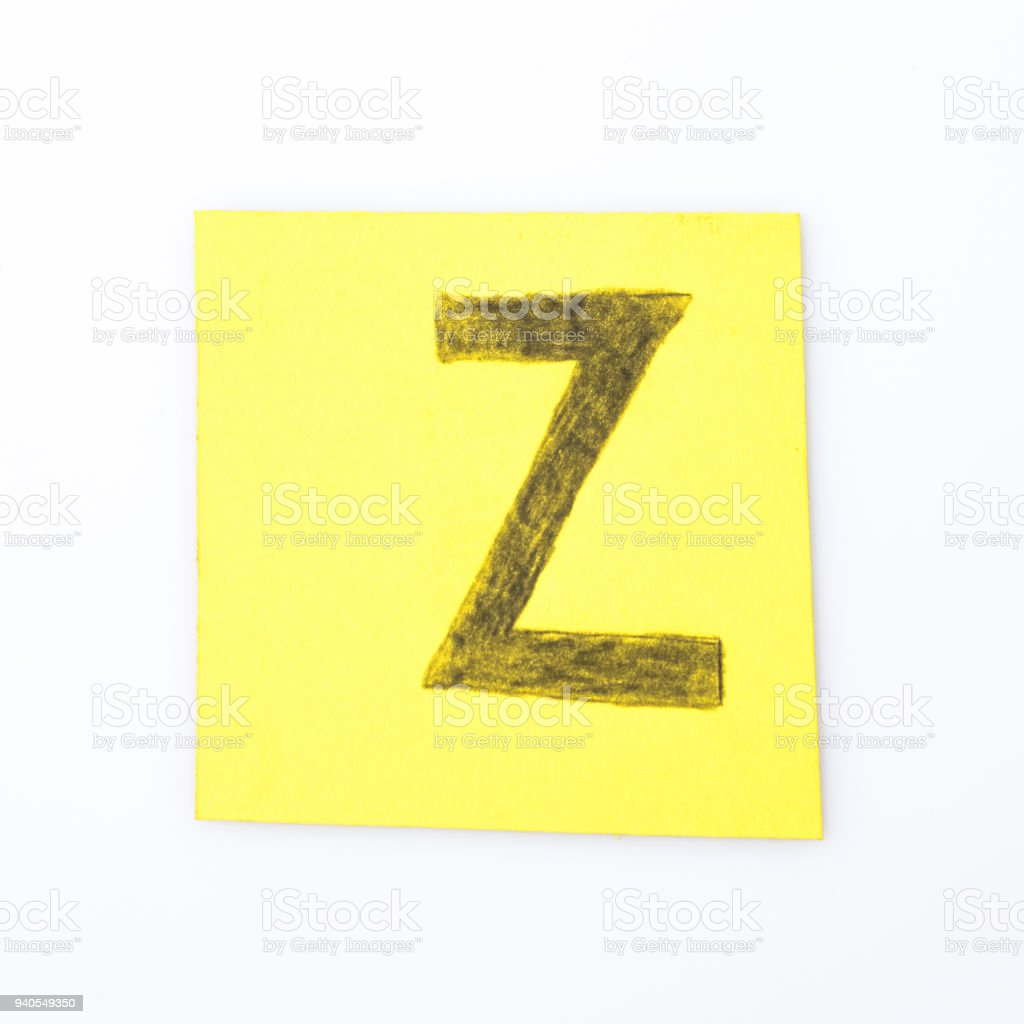 Z letter handwrite on a yellow paper composition stock photo
